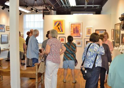 Art reception with art on the walls for NorthCountryARTS