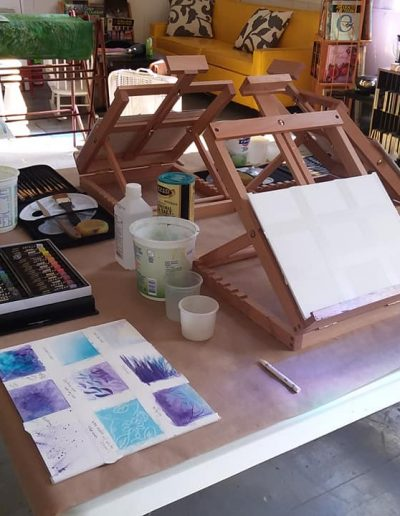 Easel and paints in a studio